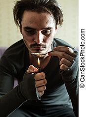 Addict in depression preparing dose of heroin. Abuse of...