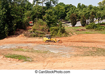Yellow Equipment Working Dirt Field