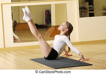 Little gymnast working out in gym - Little gymnast girl...