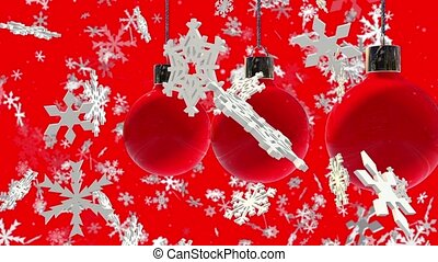 Decorations in red and slowly falling snowflakes on red