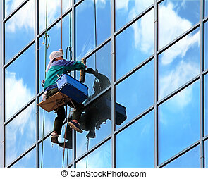 550_02899(0).jpg - window cleaner hanging on rope at work on...