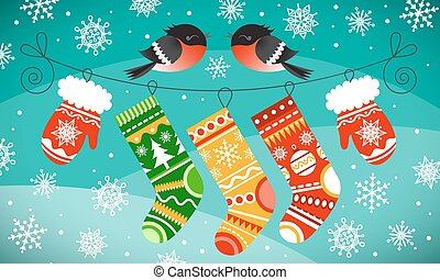 Bullfinches on the line with Christmas gloves and socks. Snowflakes and snowy hills background.