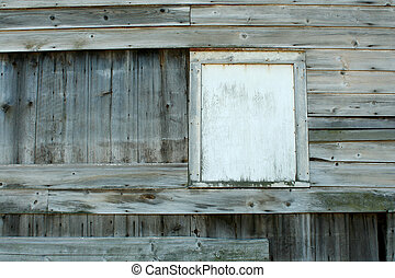 Old boarded up window - a Old boarded up barn window