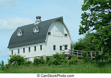 Old white barn - A Old white barn with blue sky