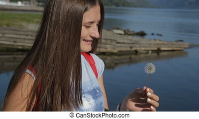 Young Woman Blowing Dandelion - Beauty Young Woman Blowing...