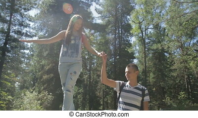 Happy couple having fun outdoors. - Young man and woman are...