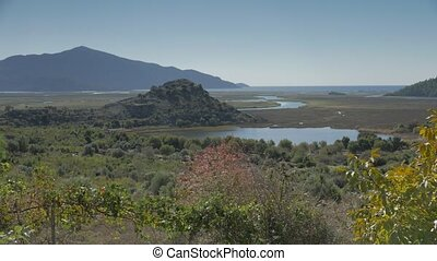Ancient city walls with a view of the Dalyan estuary and...