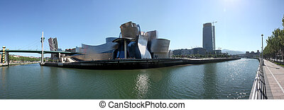 Bilbao Nervion River as it passes by the Guggenheim and...