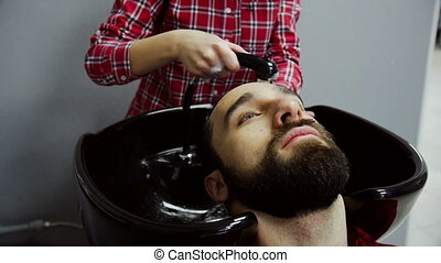 Barber Washing Male Hair in a Barbershop. Slow motion
