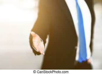 business man with an open hand ready to seal a deal - A...