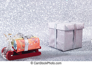 Money on sledge as a symbol of Christmas gift