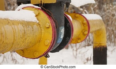 yellow gas pipe in the snow winter gas heating - yellow gas...