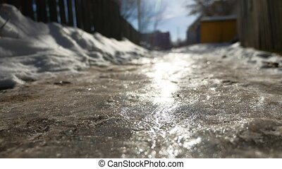 footpath in the city of ice and snow is slippery winter...