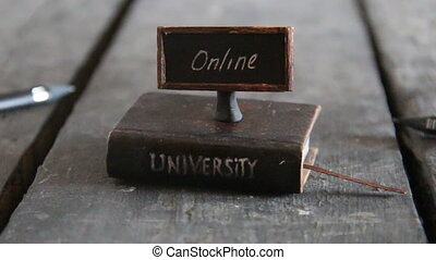 university online courses - Book - computer and inscription...