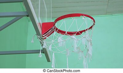 basketball hoop and a billboard sport in the school gym