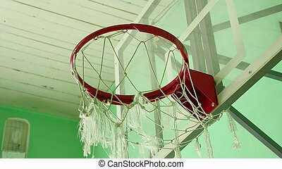 basketball hoop and a billboard in the school gym sport