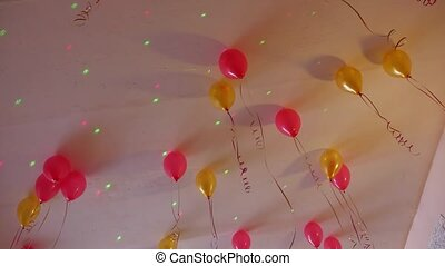 red yellow balloons hanging on the ceiling of holiday - red...