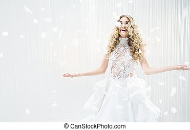 Sensual blond woman in a large bright room
