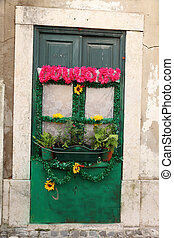 Door of an old house in Faro, Portugal