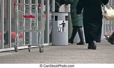 winter people go to the supermarket door opens, market shop...