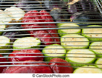 slices of pepper, eggplant and zucchini on the grill
