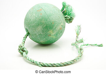 Well used green trawler net float with frayed coloured...