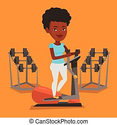 Woman exercising on elliptical trainer. - An african woman...