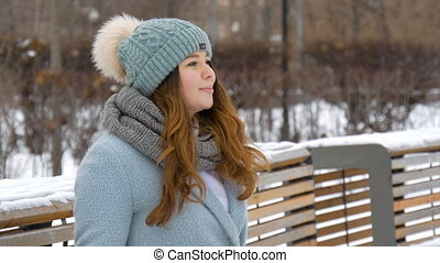 Beautiful young model smiling in winter.