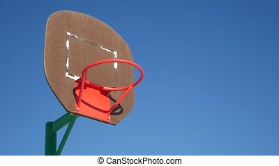 old basketball hoop, street basketball throw the ball in the...