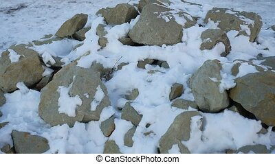 granite stones lying in the snow background - granite stones...