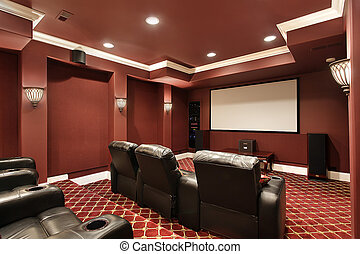Theater room with stadium seating - Theater room in luxury...