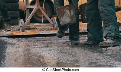 Pouring, Laying Concrete at the Construction Site using...