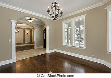 Living room in new construction home with foyer view