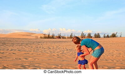 Backside Mother Small Girl Join Hands Run on Dunes at Sunset...