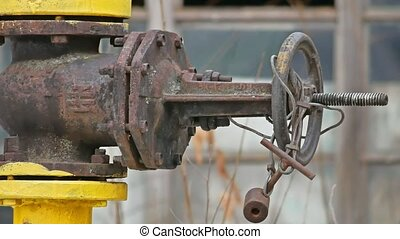 gas yellow valve vent pipe old outdoor