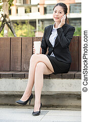beautiful asian business woman drinking coffee use smart...