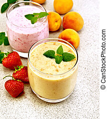 Milkshake apricot and strawberry on granite table - Two...