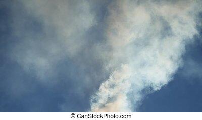 white smoke against a blue cloud sky sunlight nature landscape