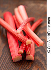 Fresh rhubarb on a wooden board Shallow DOF