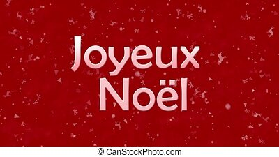 """Merry Christmas text in French """"Joyeux Noel"""" turns to dust from bottom on red animated background"""