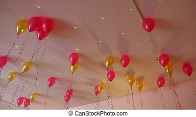 red balloons yellow hanging on ceiling of holiday - red...