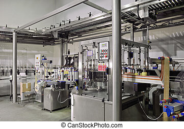 Automated labeling machine in a modern winery