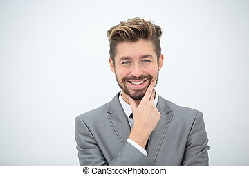 Close up portrait of a smiling handsome business man over...
