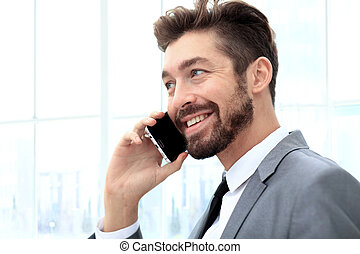 Talking business over the phone and smiling - Businessman...