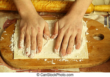 Preparation of the dough the women's hands - Preparation of...