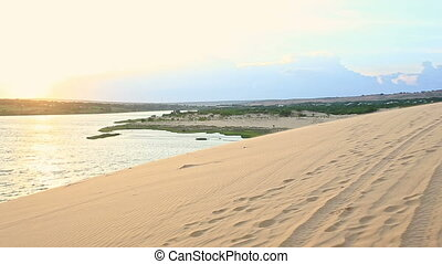 Mother Carries Small Girl on Shoulders on Dunes at Sunset -...