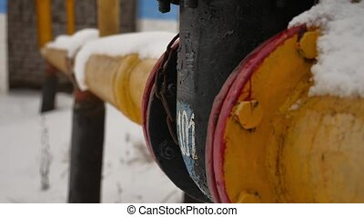 yellow gas pipe in the snow gas winter heating - yellow gas...