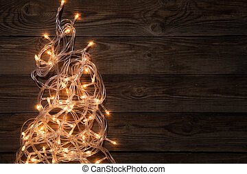 Glowing festoon on brown background, - Glowing festoon on...