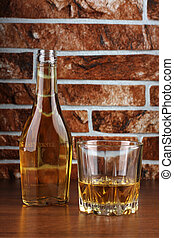 Bottle glass and stones wall - Glass and bottle wine on...