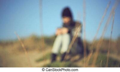 Teen girl using smartphone on the beach. Handheld shot